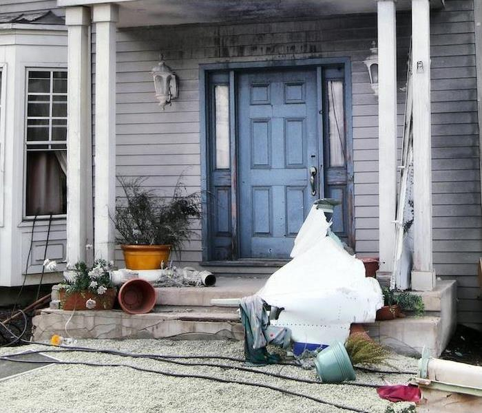 front porch of residential property in need of repairs, restoration and deep cleaning